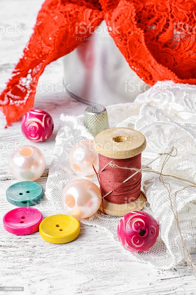 Thread,button and fabric stock photo