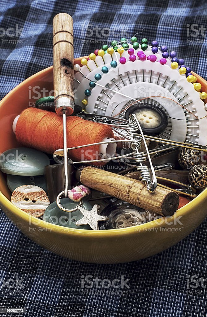 thread,button,crochet hook, and other sewing tools royalty-free stock photo