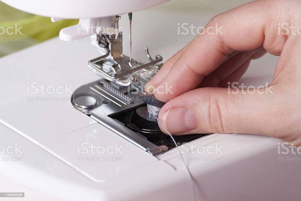 Threading a Sewing Machine stock photo
