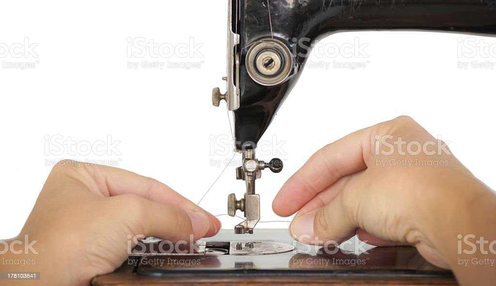Threading a vintage sewing machine royalty-free stock photo