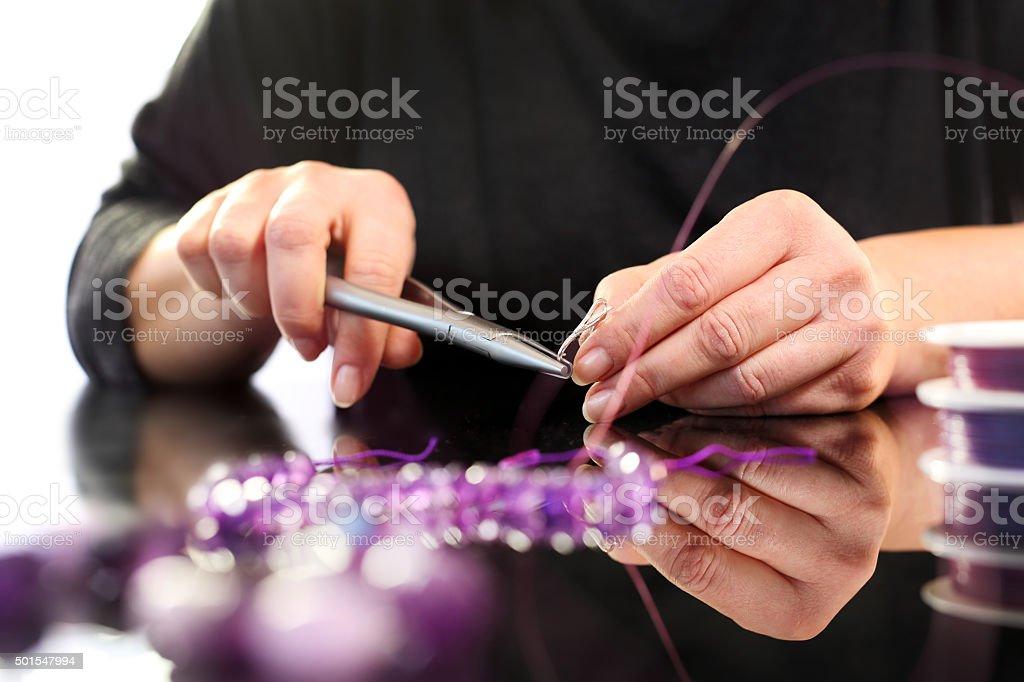Threading beads, jewelry workshop stock photo