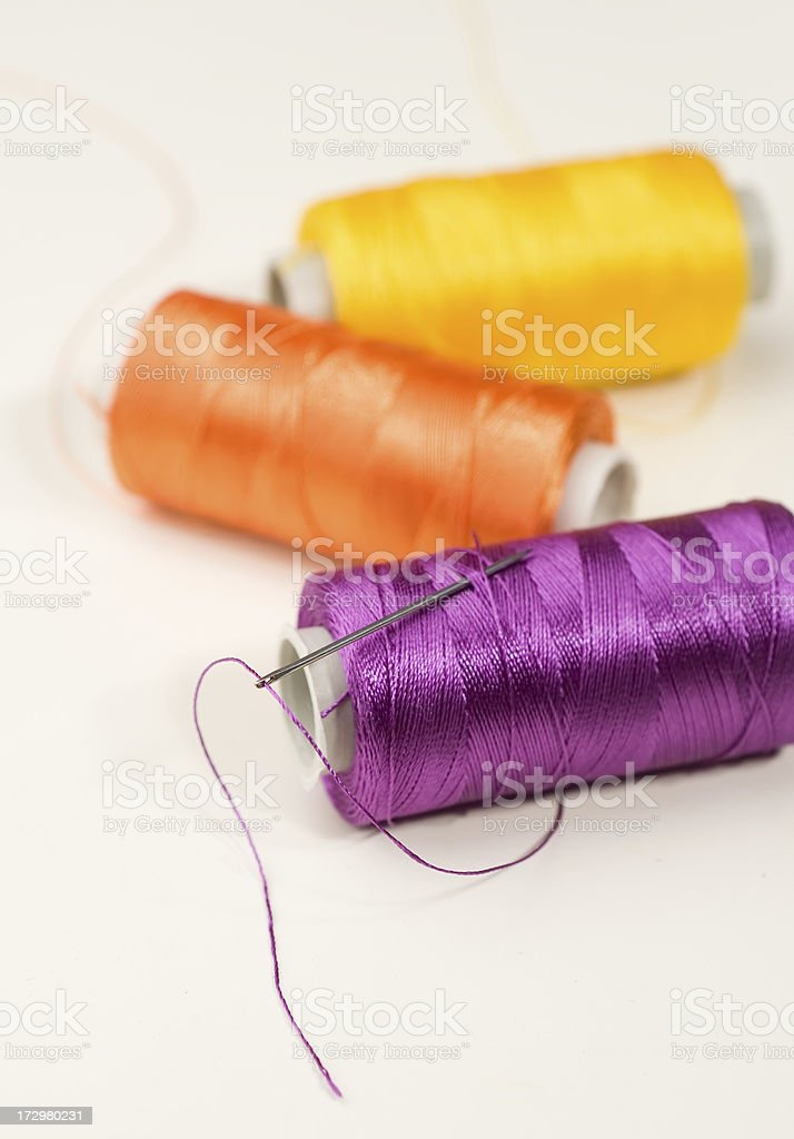 Threads and needle royalty-free stock photo