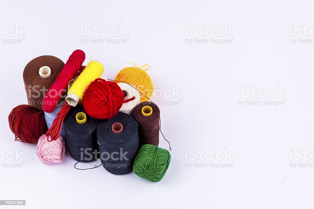 Threads and wool - white background royalty-free stock photo