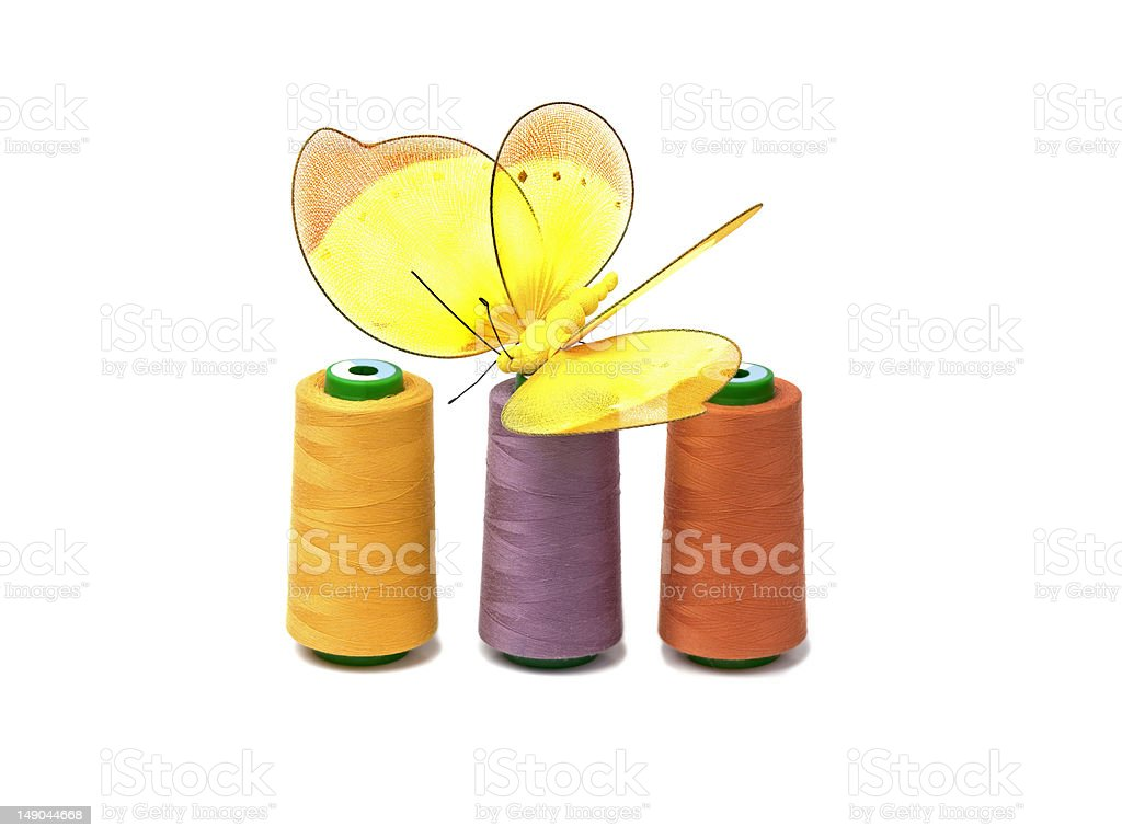 Threads for sewing and butterfly royalty-free stock photo