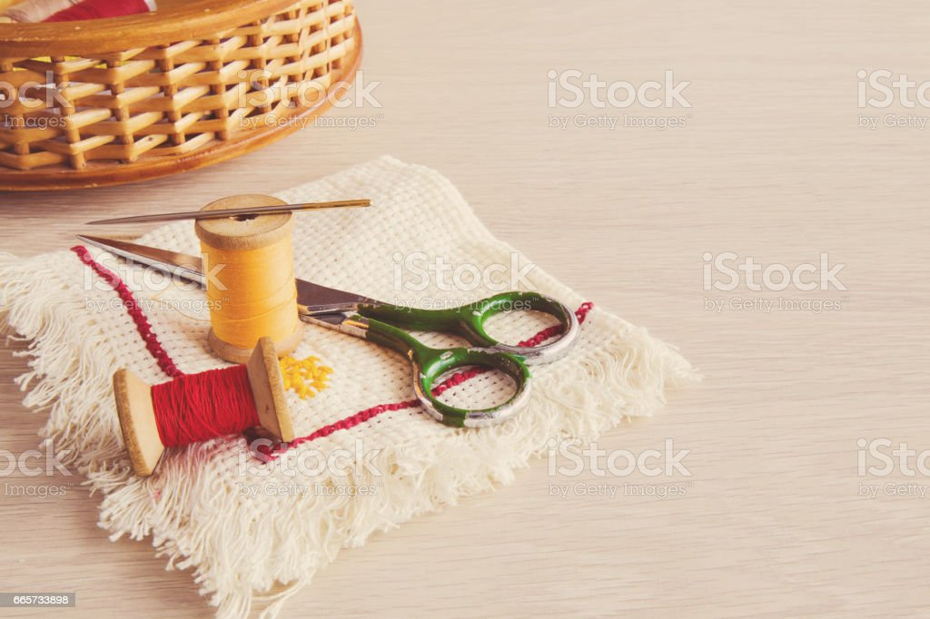 Threads, needle, scissors and cloth - basic accessories starting sewing. Sewing works. Handmade. stock photo