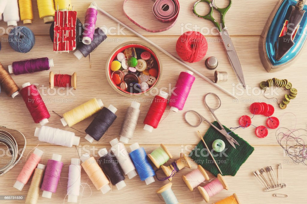 Threads, needles, scissors and buttons - basic accessories starting sewing. Sewing works. Handmade. Womanly hobby. stock photo