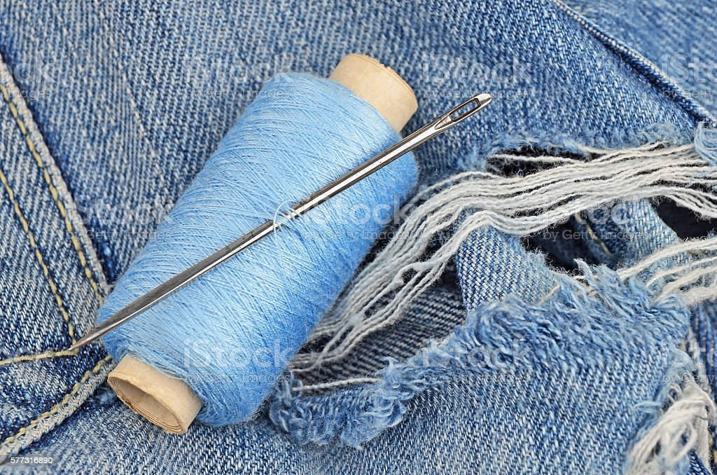 Threads on jeans, wear repair concept stock photo
