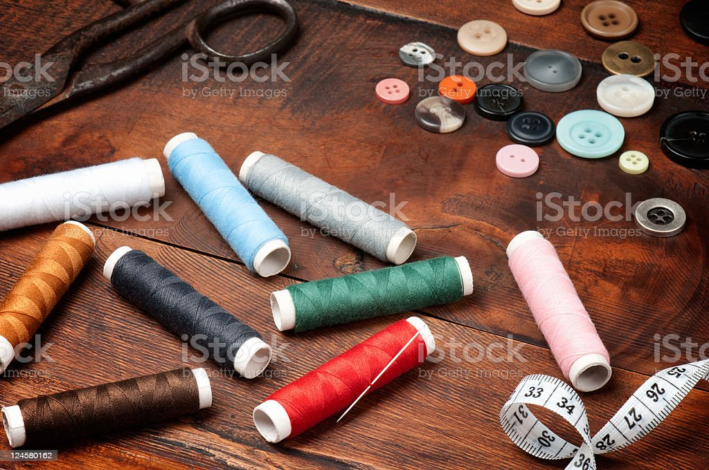 Threads, scissors and buttons royalty-free stock photo