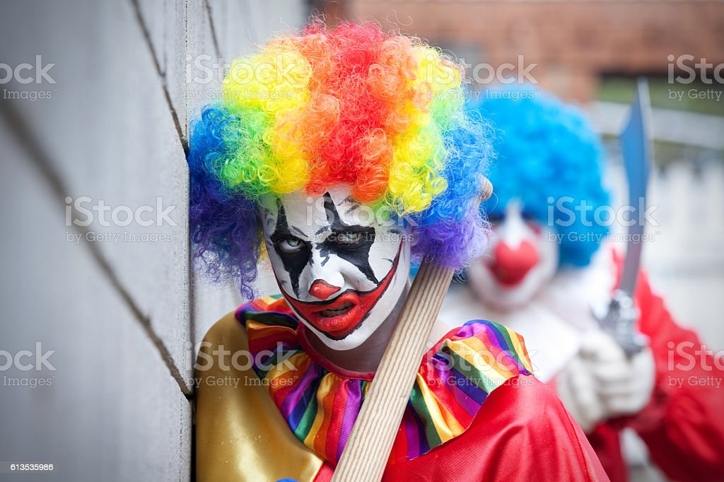 Threatening Creepy Clowns stock photo