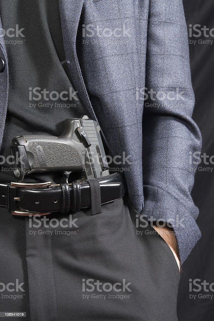 Threatening gesture - Revealing a handgun royalty-free stock photo