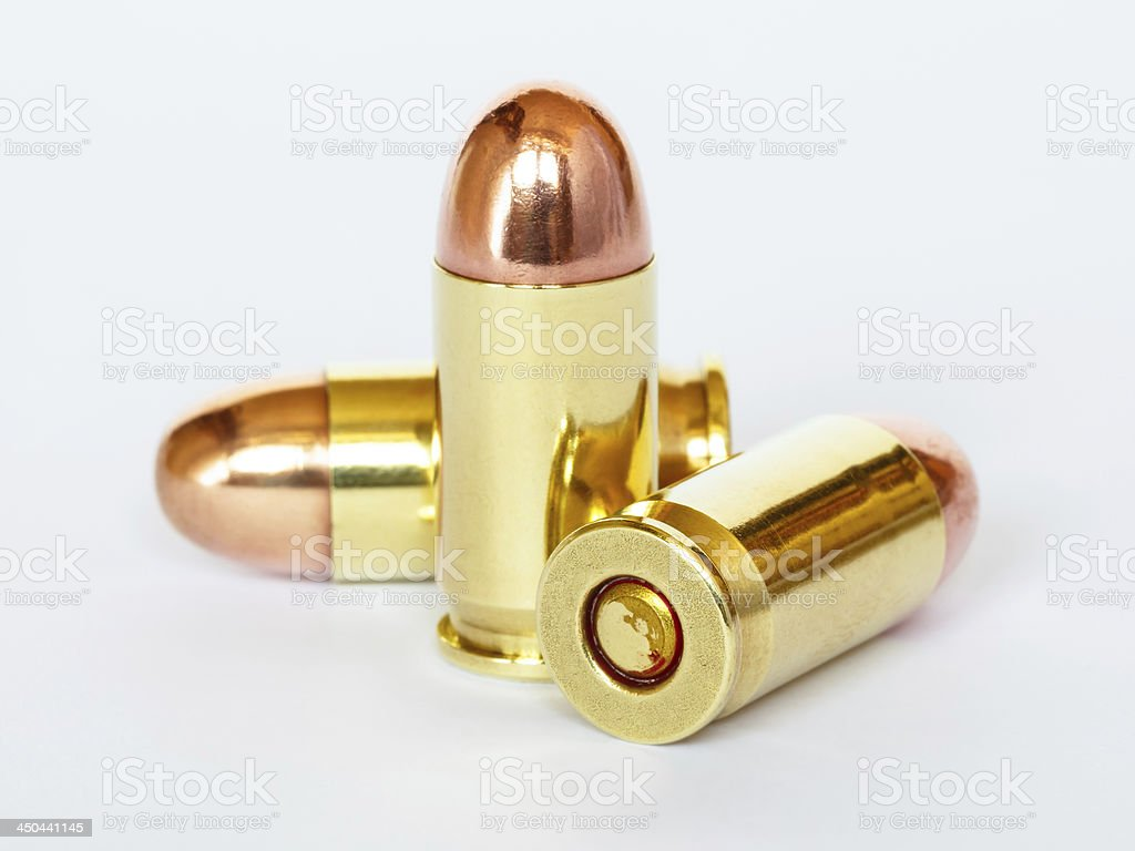 Three 9 mm or .357 bullet on white background stock photo