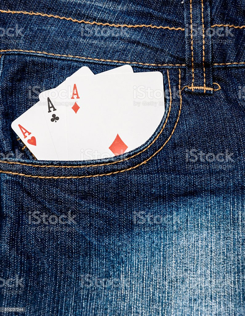 Three aces in jeans pocket stock photo