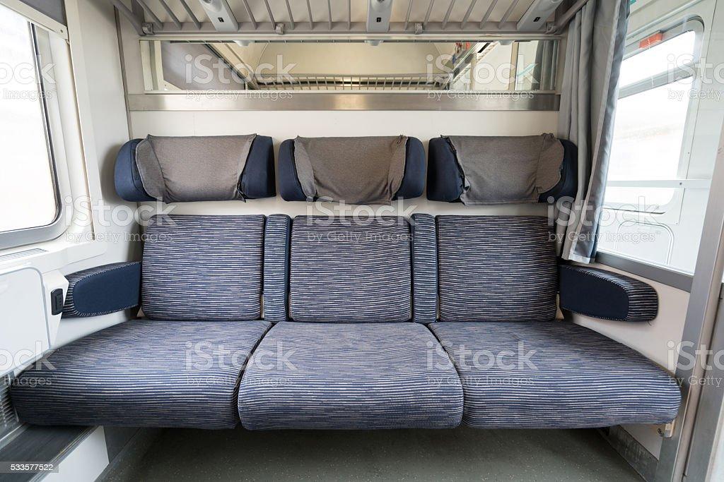 Three adjacent empty seats on modern European train stock photo