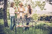 Three adult women having picnic