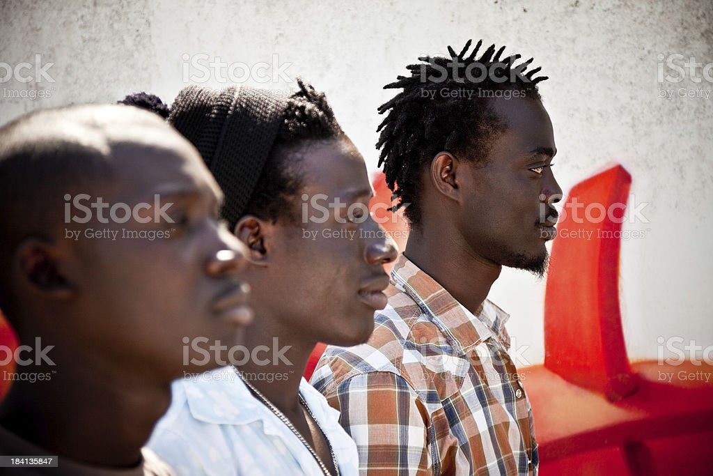 Three Africans Men In A Row, Looking At Horizon royalty-free stock photo