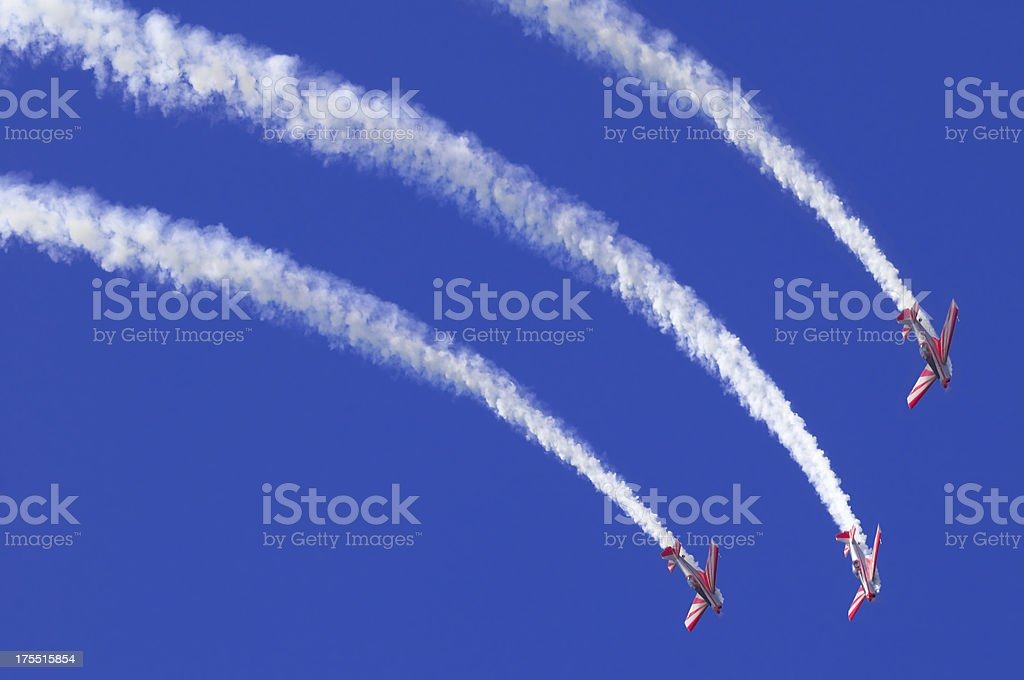 Three airplanes during an airshow stock photo