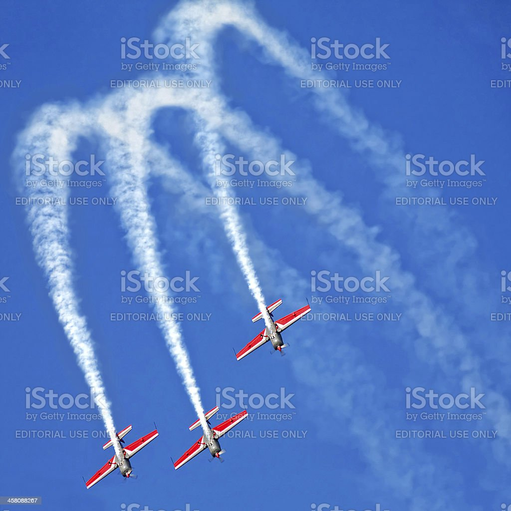three airplanes Extra EA-300 in formation on airshow royalty-free stock photo