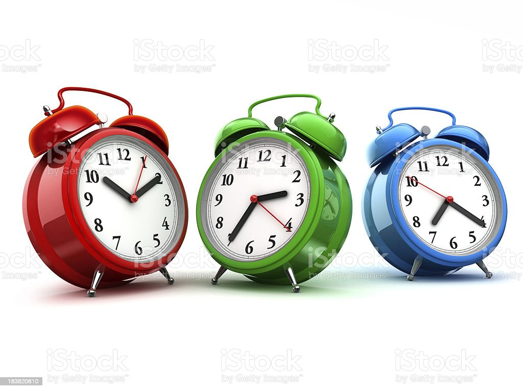Three alarm clocks stock photo