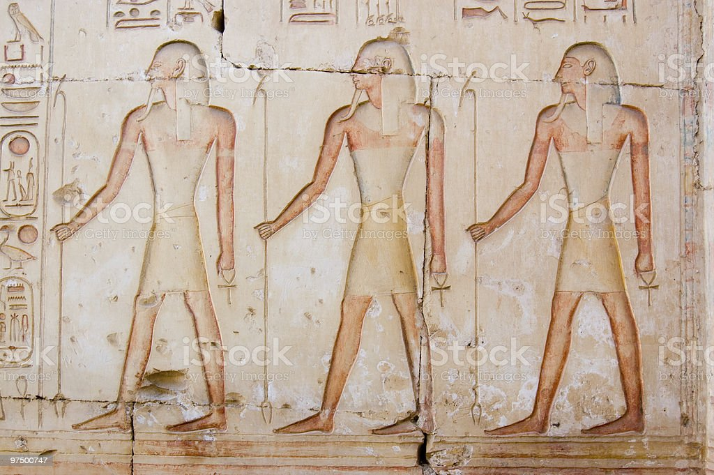 Three ancient egyptian priests stock photo