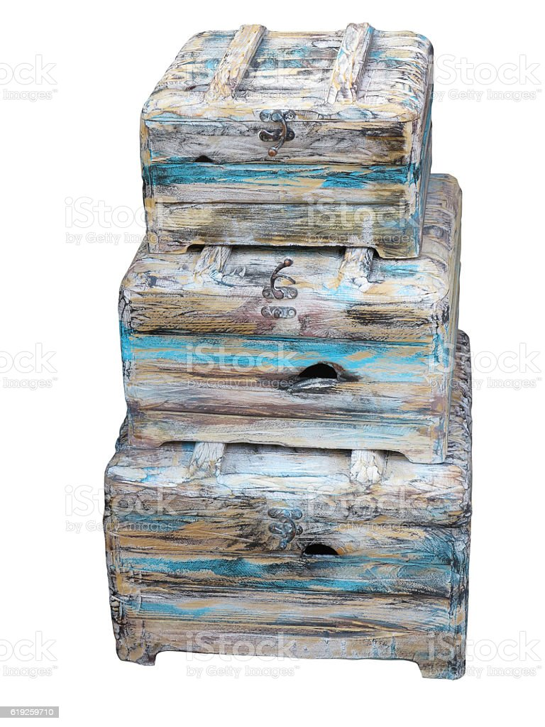 Three ancient vintage chests isolated over white stock photo