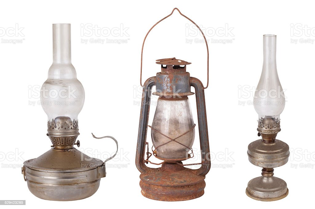 Three antique kerosene lamps isolated on white background stock photo