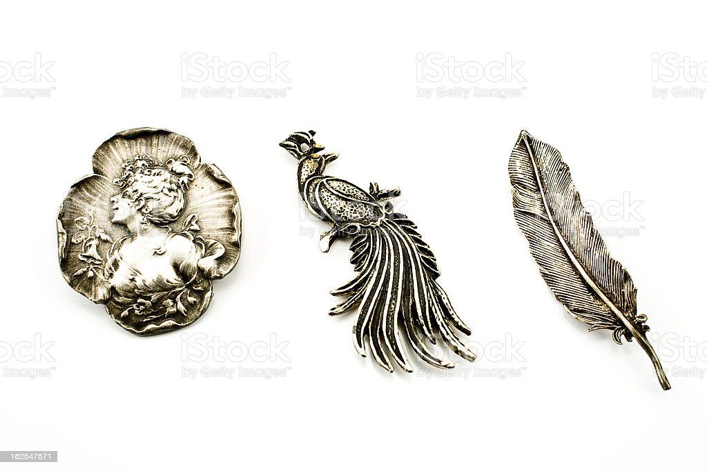 Three antique silver brooches royalty-free stock photo