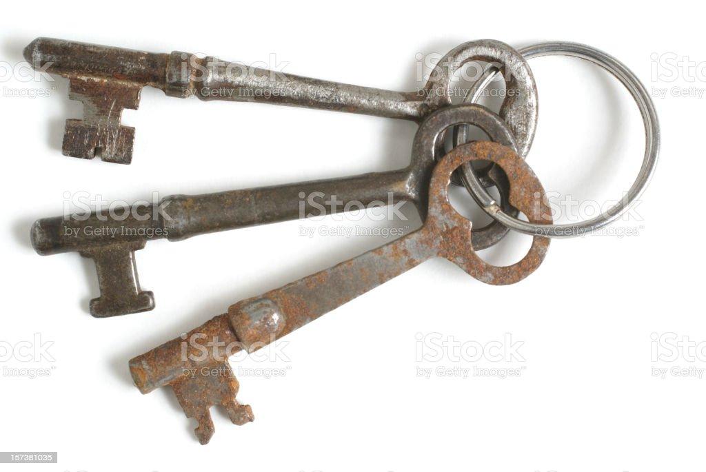 three antique skeleton keys on ring royalty-free stock photo