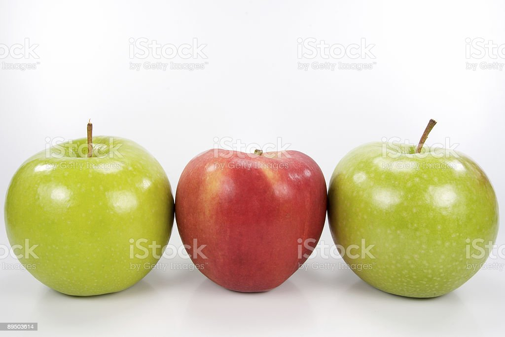 Three apples in a row royalty-free stock photo