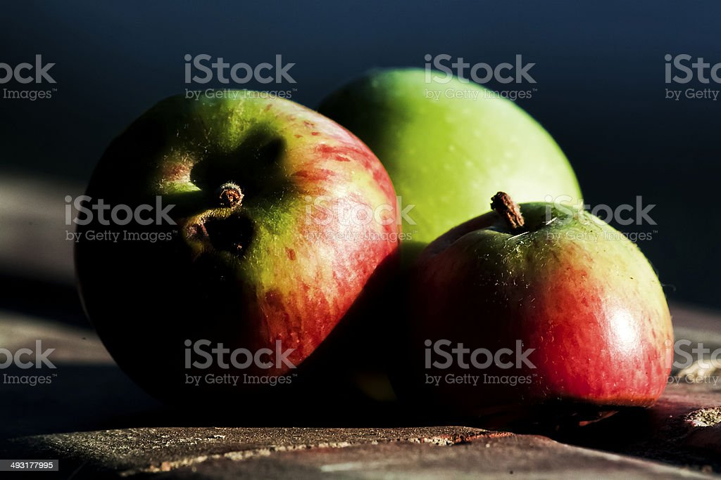 Three Apples in the shadow royalty-free stock photo