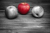 Three apples on dark wooden background