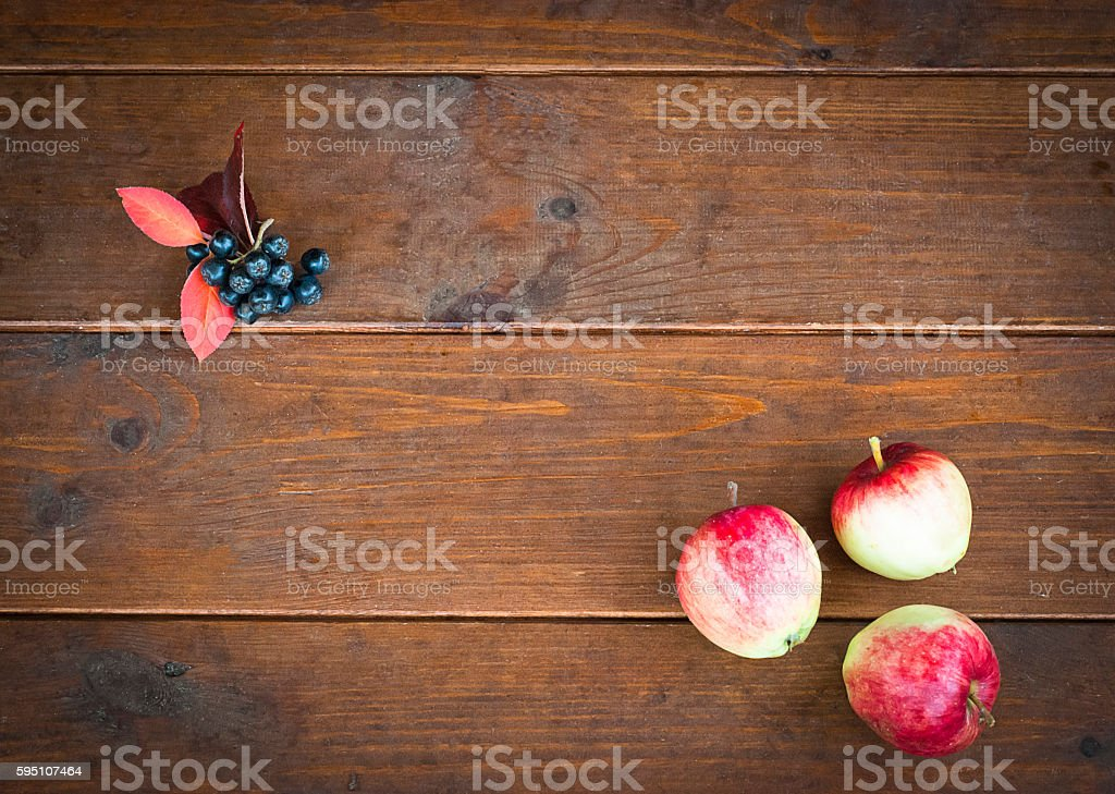 Three apples on the old wooden floor stock photo