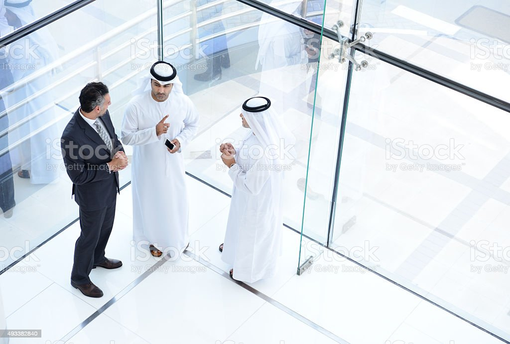 Three arab business men meeting stock photo