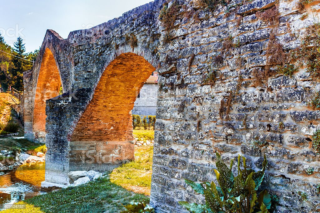 three archs medieval humpback bridge in Italy stock photo