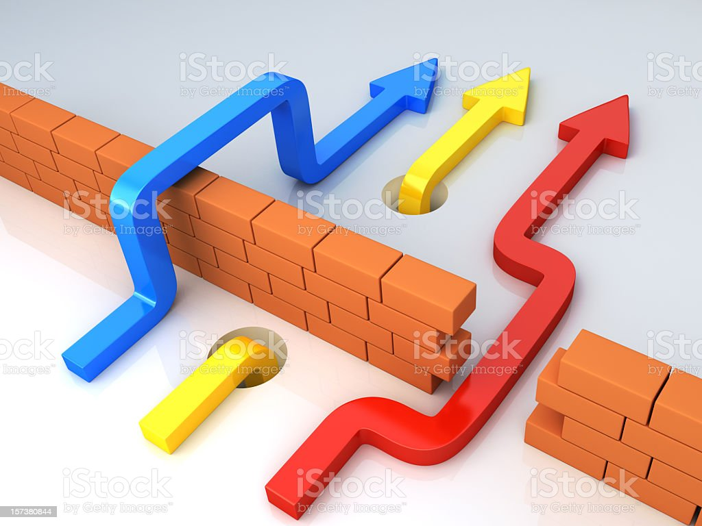 Three arrows going past a brick wall stock photo