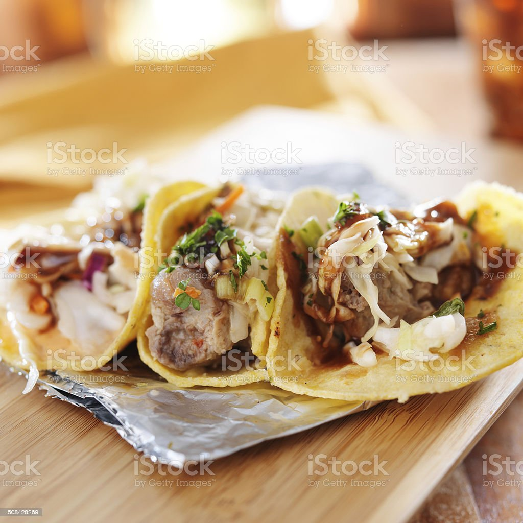 three asian pork tacos stock photo