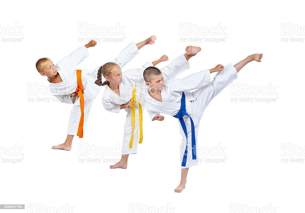 Three athletes are beating kick leg stock photo