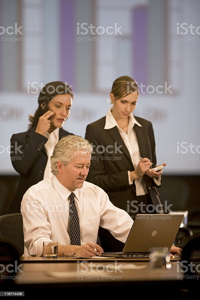 Three Attractive Business People At Work royalty-free stock photo
