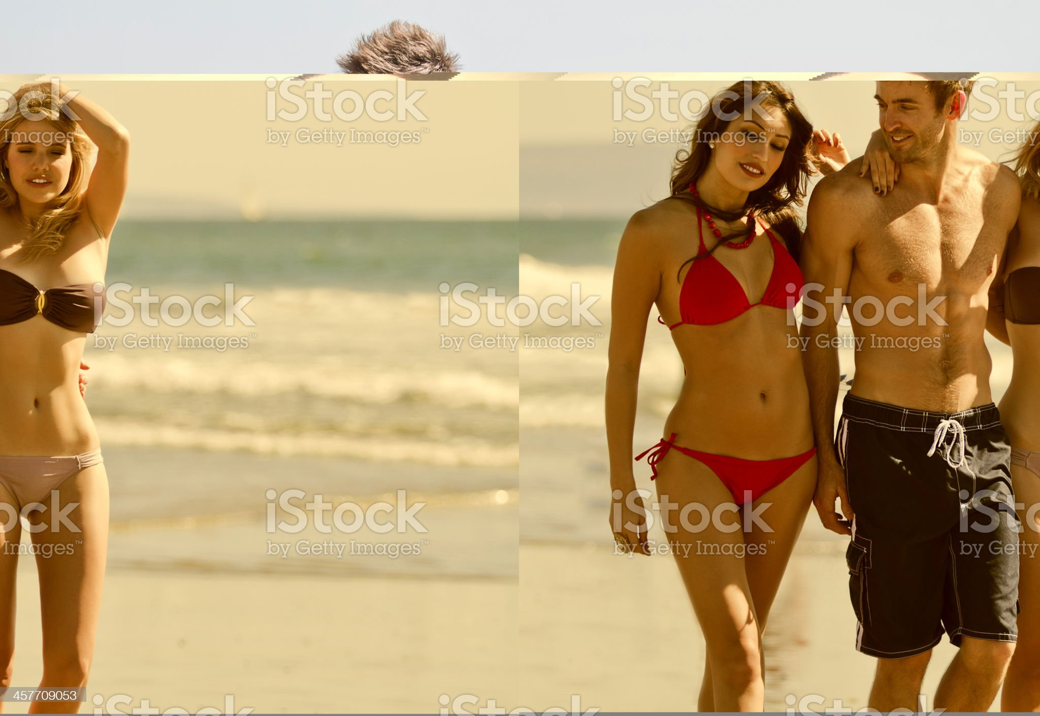 Three Attractive Friends Walking On The Beach royalty-free stock photo
