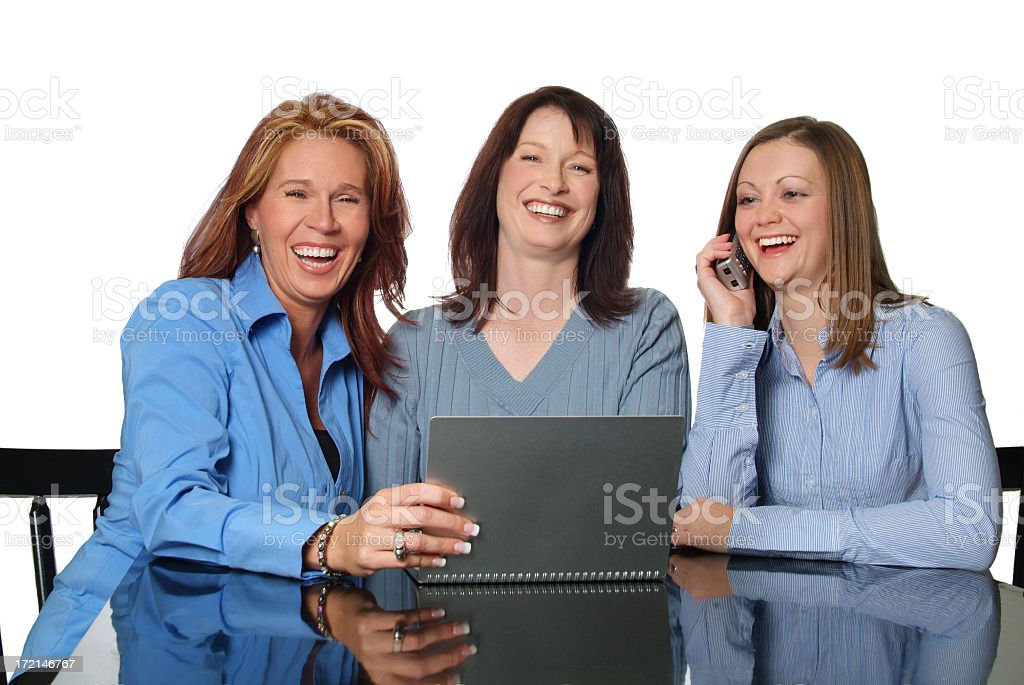 Three Attractive Women Having Fun Working Together royalty-free stock photo