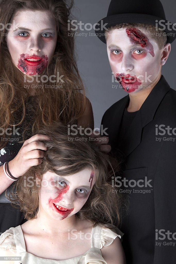 Three Attractive Young Zombies stock photo
