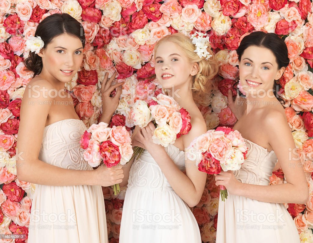 three bachelorette  women with flowers over roses background stock photo