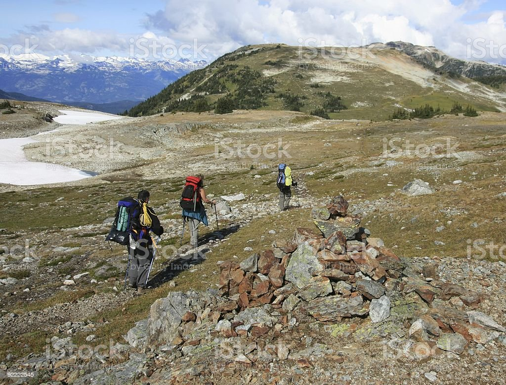 Three Backpackers at Oboe Summit stock photo