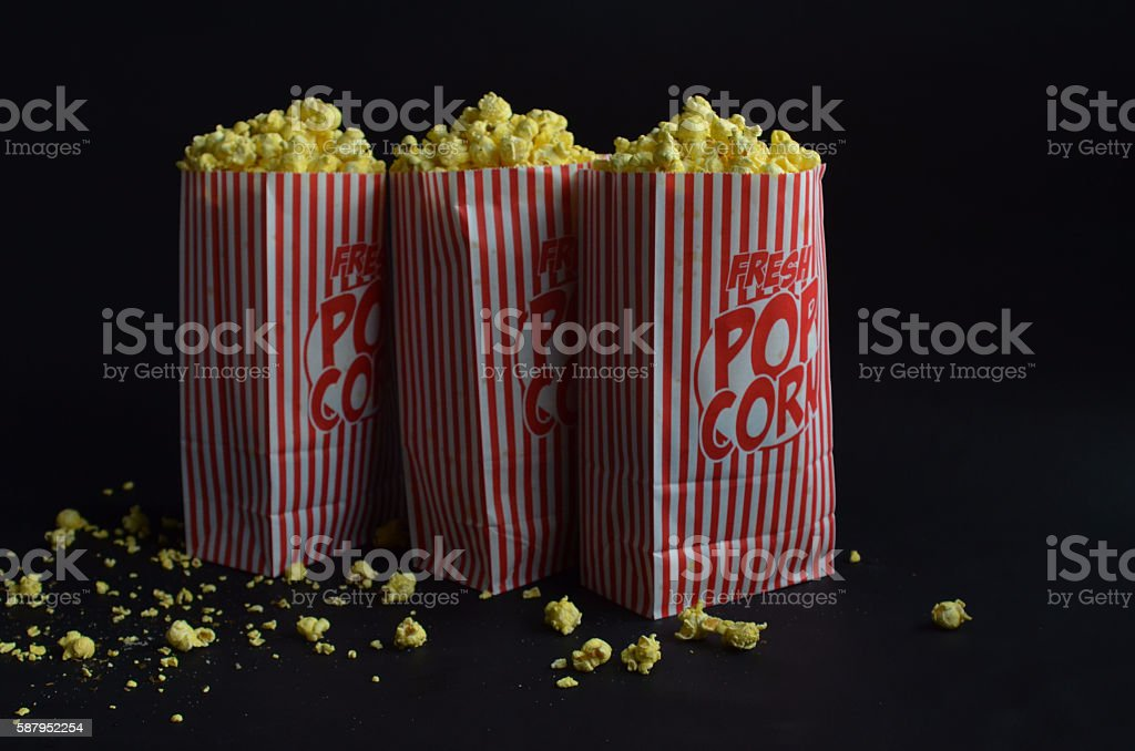 three bags of buttered popcorn stock photo
