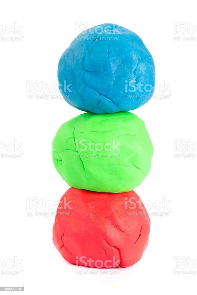 Three balls of play doh stock photo