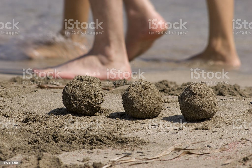 Three balls of sand stock photo