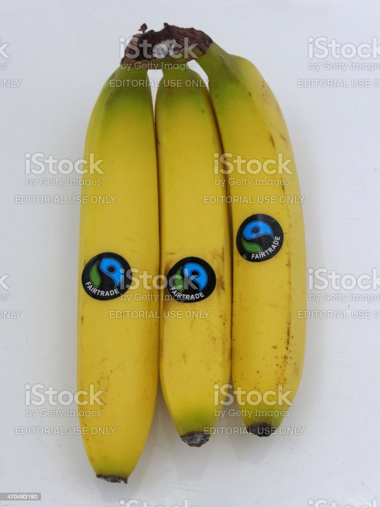 three bananas with fairtrade label stock photo