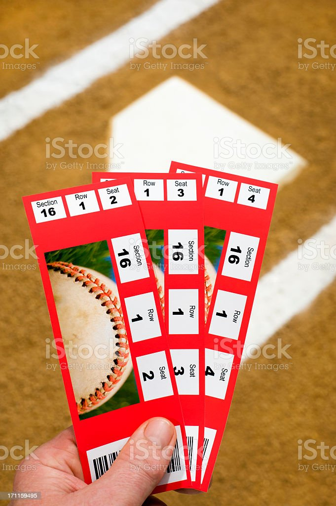 Three Baseball Tickets with home plate in background stock photo