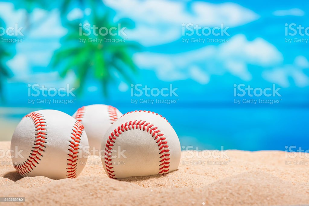 Three Baseballs on the beach for Spring Training Grapefruit League stock photo