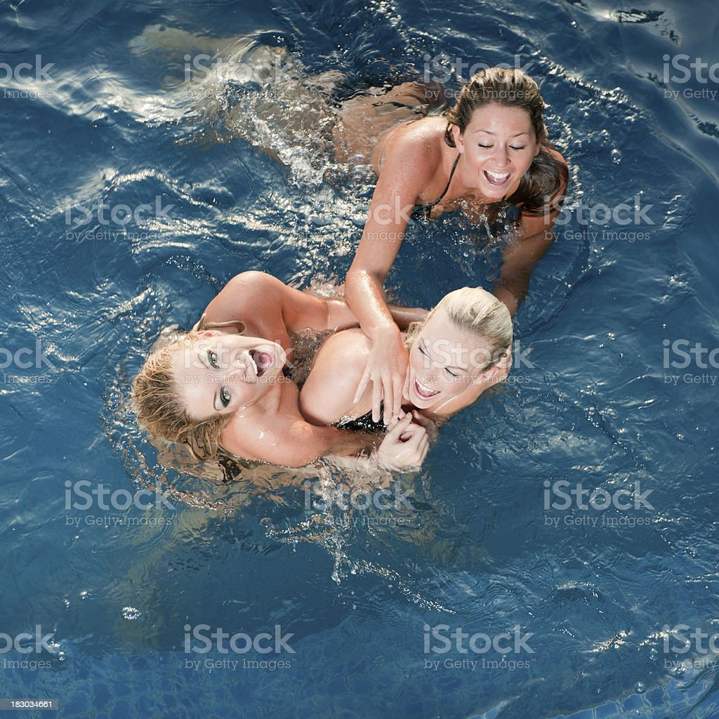 Three Beauties playing in the Pool (XXXL) royalty-free stock photo
