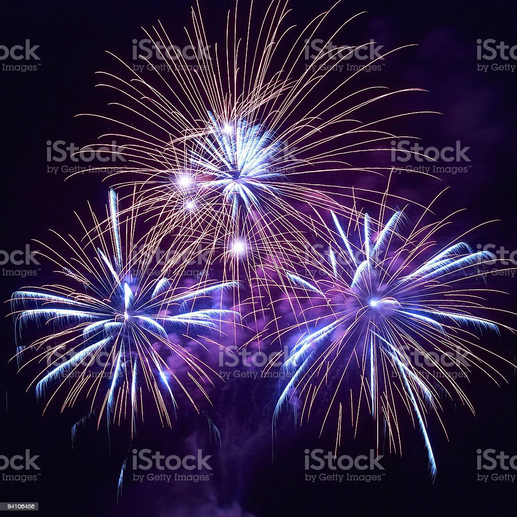 Three beautiful blue and red fireworks at night royalty-free stock photo
